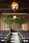 green indoor wedding ceremony backdrop