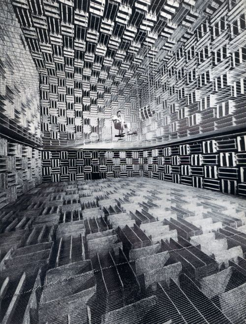 1940: A Bell Laboratories scientist performs an acoustic experiment in the Murray Hill Anechoic Chamber. The chamber was 'anechoic,' meaning 'without echo,' absorbing over 99.995% of the incident acoustic energy above 200 Hz. Large fiberglass wedges were mounted on the walls absorbed sound reflections.