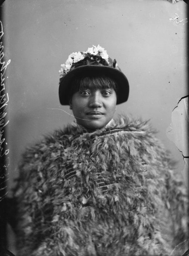 Maori woman from Hawkes Bay district wearing European hat with traditional feather cloak. Photo taken 11 May 1889 by Samuel Carnell of Napier
