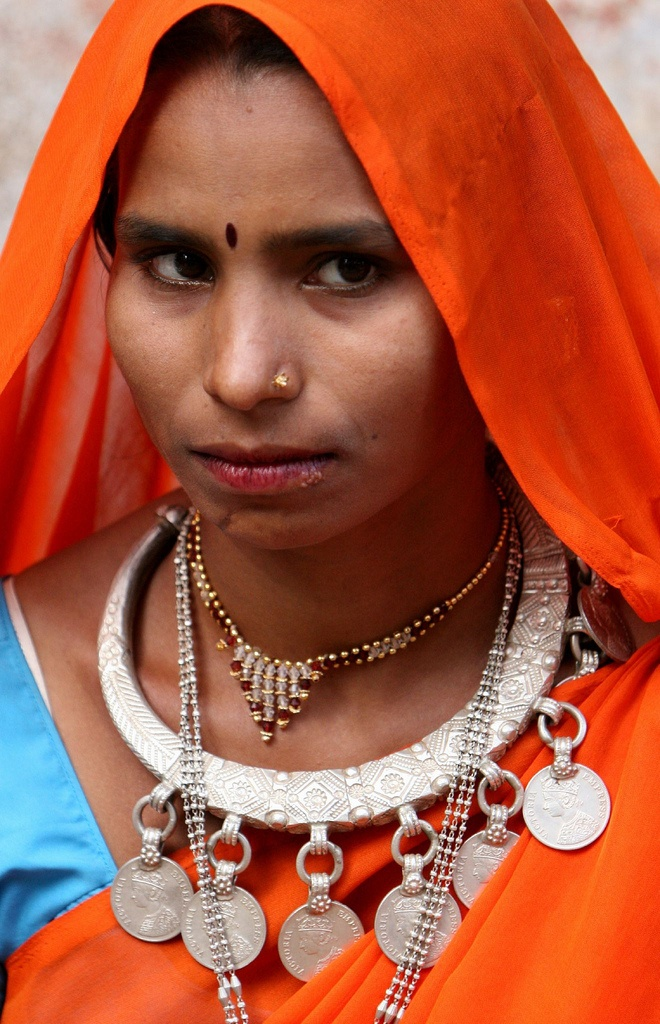 India ~ Gujarat   'An the market of Kawant (Eastern part of Gujarat) you meet a lot of tribal people; most of them are Bhil people; other tribes are Rathwa or Nayak.  Specially the Bhil women wear beautiful necklaces and jewellery; other tribes have facial tattoos.'   Image and caption  © Walter Callens