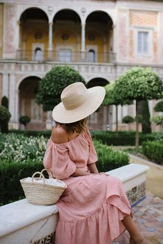 Classy in Seville - pink off the shoulder dress and straw bag for a classic travel outfit.  also cute casual spring outfit
