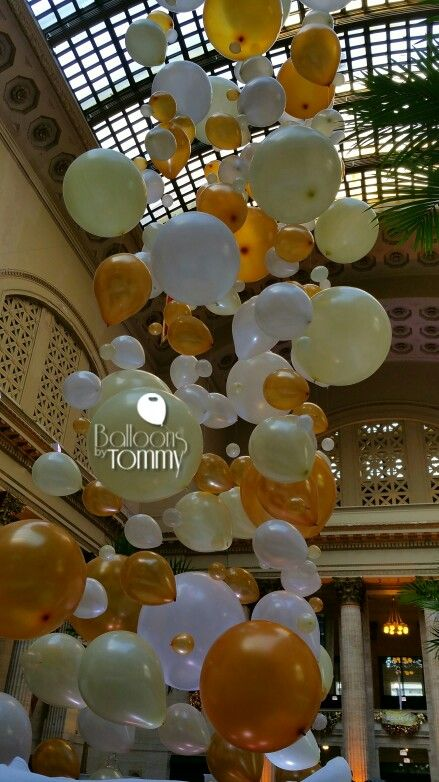A tower of floating balloons for a great gatsby themed for Balloon decoration chicago