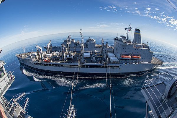 The fleet replenishment oiler USNS Yukon (T-AO 202) conducts a dual replenishment-at-sea with the aircraft carrier USS Carl Vinson (CVN 70) and the guided-missile cruiser USS Princeton (CG 59). The Carl Vinson Carrier Strike Group (CSG) will report to U.S. 3rd Fleet, headquartered in San Diego, while deployed to the western Pacific as part of the U.S. Pacific Fleet-led initiative to extend the command and control functions of 3rd Fleet into the region.  U.S. Navy photo by Mass Communication…