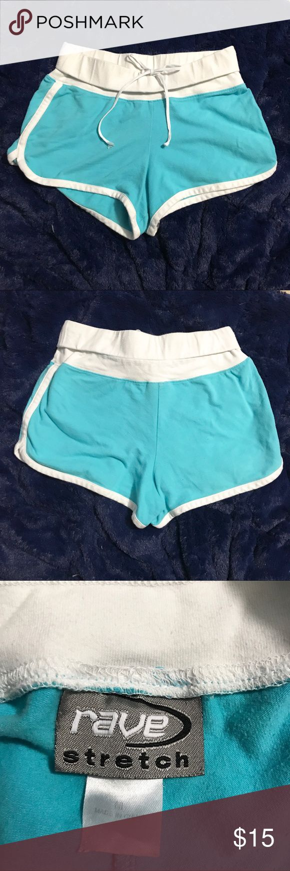 Rave Stretch Aqua Shorts 95% cotton. 5% Spandex. Aqua Shorts. Tag is a little warn. Rope tie is fraying near ends. Size is medium. Pre-loved. Neon. Rave Stretch Shorts