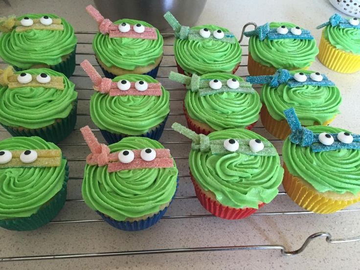 Ninja turtle cupcakes - vanilla cupcakes filled with blueberry jam, topped with green buttercream - I cut think strips of sour straps for the bandanas and used sugar eyes to complete the look.