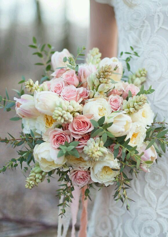 Beautiful wedding bouquet with soft pink roses and succulents.
