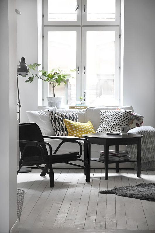 Add a bright punch of color to your neutral space with pillows and other home accessories. #decor. #livingroom. #blackwhite