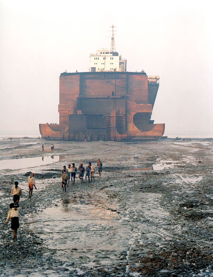 Ship breaking is one of those visually tragic sights. Tragic for the workers who risk their lives in this dangerous job, and tragic for the image of these majestic behemoths being butchered.  Edward Burtynsky is an amazing artist.  http://www.edwardburtynsky.com/index.htmlshb_21_00.jpg