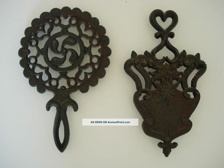 Two Antique Victorian Trivets Cast Iron From England - late 1800s early 1900's - value under $20 each