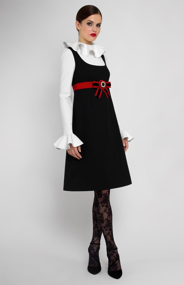 Combined A-shape long-sleeve stretchy cotton dress. Flounce collar and sleeves. Button down with hidden back zip closure. Without pockets. Designer handmade bow on a decorative belt.