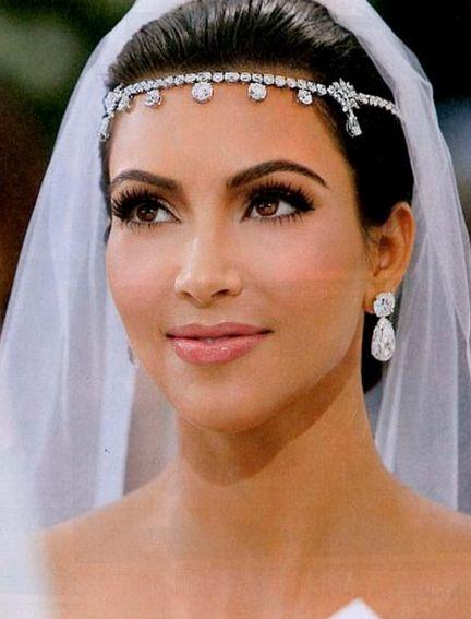 Kim Kardashian's bridal makeup was simply flawless! #JovaniBridal jb26361 http://www.jovani.com/wedding-dresses/jb26361