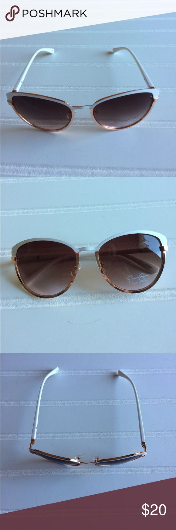 🆕 Jessica Simpson White and Gold Sunglasses Jessica Simpson white and gold Sunglasses.   There are Gradient lenses. Top of the lenses are pink. Lower is clear. Could not get a picture reflecting the pink color.   No case.   100% UV Protection   Offers welcome Jessica Simpson Accessories Sunglasses