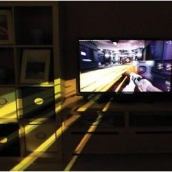 Le projet IllumiRoom de Microsoft Research utilise un projecteur classique pour faire entrer le jeu vidéo dans la salle de séjour du joueur.