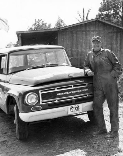 John Wayne Poses with International Truck