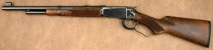 """Winchester 1894 Carbine .444 Marlin s/n """"R.L.K.1"""" mfg 2001 - George Madis signed & engraved; 17-1/2"""" round ported barrel; ¾ magazine; angled-eject receiver w/hammer block safety; deluxe pistol grip checkered walnut stocks; rubber shotgun buttplate; folding rear & hooded front sights; high-polish blued finish; jeweled breech block & cartridge elevator; provisions for tang sight. all work by Winchester (USRACO) factory custom shop."""