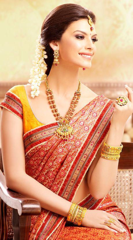 South Indian bride. Temple jewelry. Jhumkis.Red silk kanchipuram sari.Braid with fresh flowers. Tamil bride. Telugu bride. Kannada bride. Hindu bride. Malayalee bride.Kerala bride.South Indian wedding.