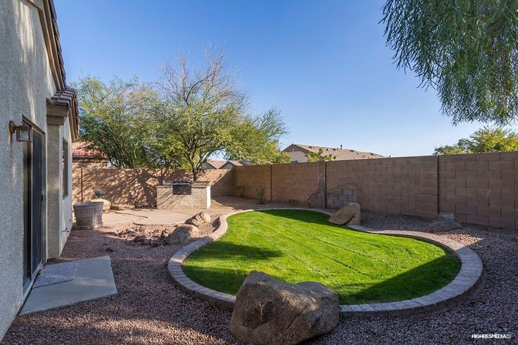 Traditional Landscape/Yard with Decorative Landscape Rock - Cactus Berry, Pathway, Fence, exterior stone floors