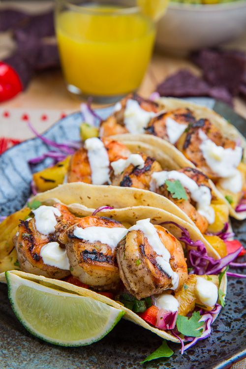 Jerk Shrimp Tacos with Pineapple Salsa, Slaw and Pina Colada Crema. I want these now!