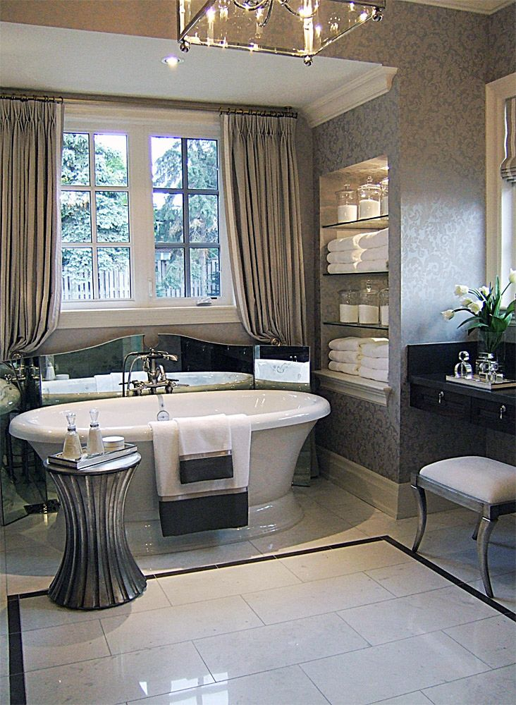 Kilgour Estate Bungalow Bathroom with mirrored furniture and silver accents