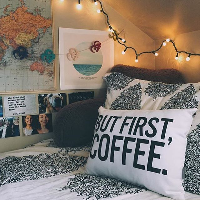 Comfy and homely bed area, including posters and personal imagery.