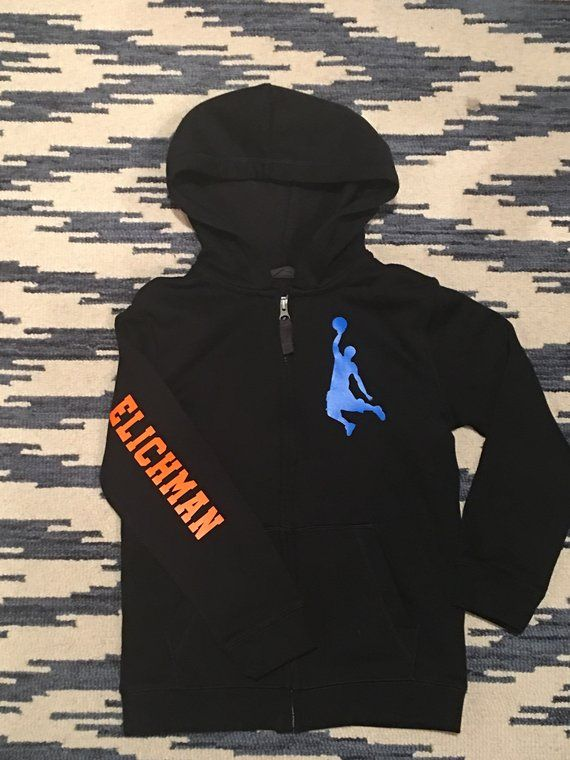 8187cffbf A comfortable custom black zip up hoodie with a neon orange and blue  basketball design.