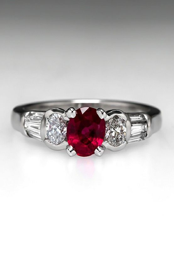 If I had this ring, the ruby would symbolize the blood of Christ, the diamond before it God, and the diamond after it His children cleansed and sanctified!