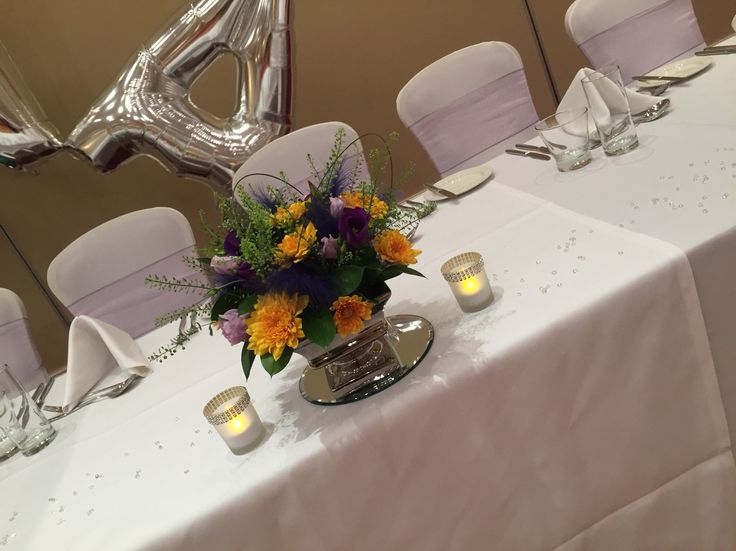 Flowers, feathers, candles and diamanté