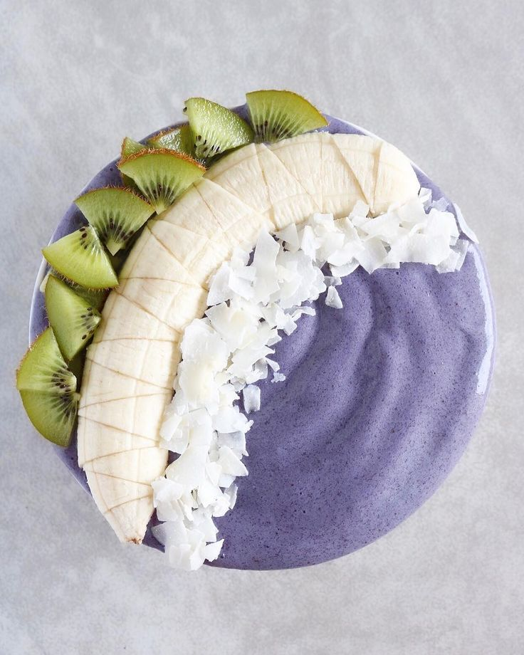 Blueberries blended with almond milk and flax, topped with banana, kiwi, and coconut. Yum!