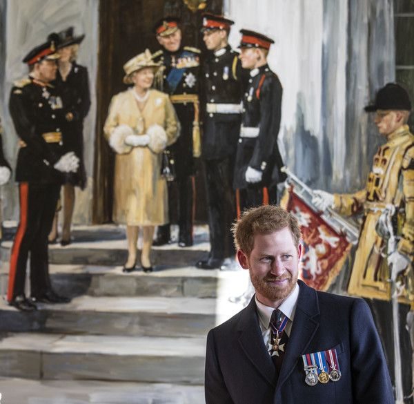 """Prince Harry Photos - Prince Harry stands beneath the painting of himself and Prince William when they were Sandhurst cadets with the Queen and other members of the royal family that hangs in the entrance to """"Old college"""" at the Royal military academy sandhurst where Prince Harry inspected this years graduating officer cadets on December 15, 2017 in Camberley, England. - Prince Harry Attends the Sovereign's Parade"""