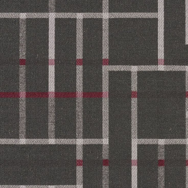 Subdivide - Asphalt | Subdivide harkens back to the Bauhaus, where architectural drawings and plans were drafted with the guiding principles and foundation of modernism. Utilizing a loom with a large horizontal repeat capability, we've created a large pattern of linework and blocks designed to be cut and sewn without having to match the repeat. Natural fibers on the surface create a soft hand, while a nylon warp provides the strength to meet 100,000 double rubs.