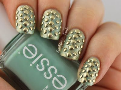 """""""I used two coats of Essie - Mint Candy Apple. Then I added one coat of Lancôme - 012 and used saran wrap to take the color off again. I wanted to have a matte finish, so I added Essence - Soft Touch Top Coat on top."""" Square and round studs where then added."""