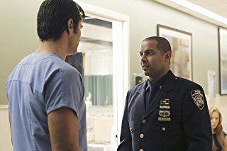 Jon Huertas and Victor Webster in Castle (2009)