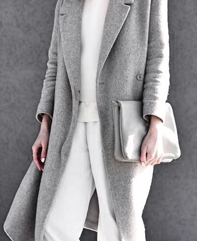 Grey coat, white pants and blouse. Latest fashion trends.
