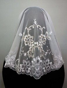 This is a brilliant and luxurious veil that is made with gold threads. It is a veil that feels like splendid and graceful because it has a big pattern design