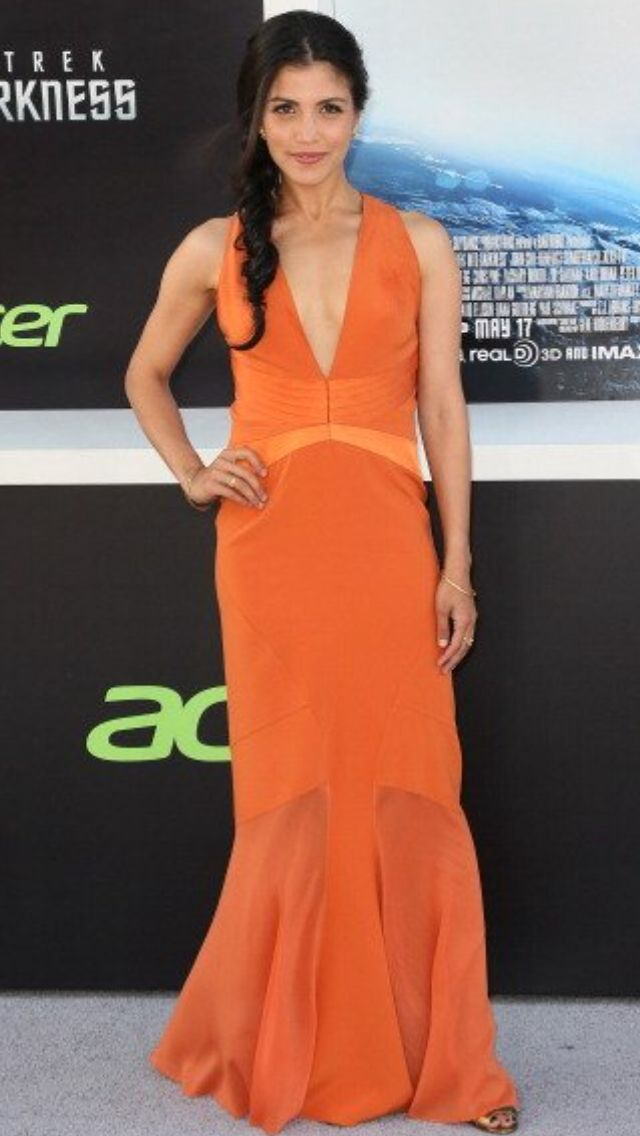 Nazneen Contractor in Orange gown.
