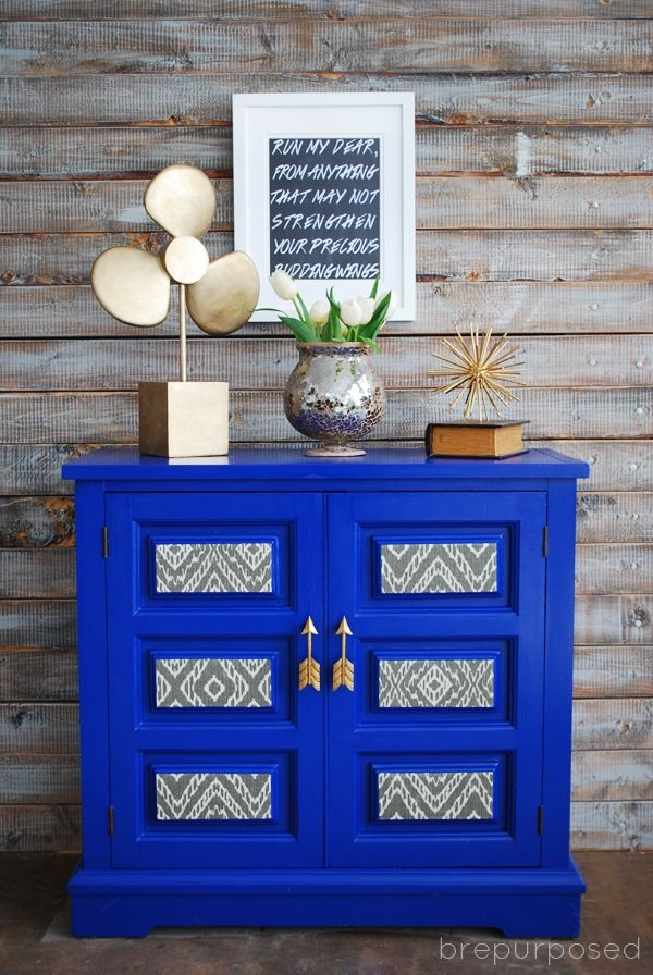 Check out how an old thrift store find gets a bold new look and is turned into a Klein Blue Cabinet with Arrow Handles!
