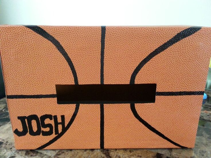 Basketball valentines box. Paper was purchased at Hobby Lobby and feels like a real basketball!