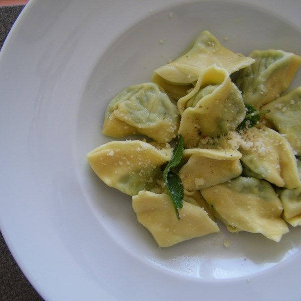 "Spinach and Ricotta Tortellini | ""Great with a simple butter and sage sauce or with your regular tomato sauce."""