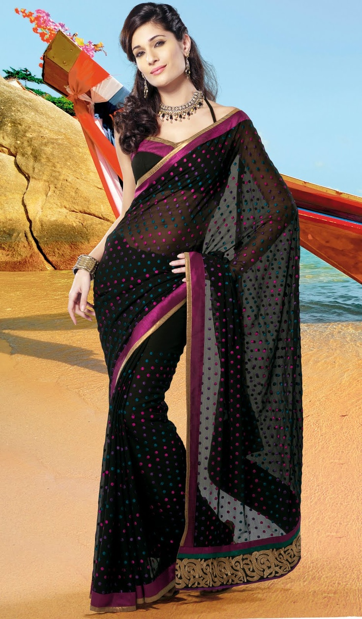 Pretty sari - nice play on polka dots - black is forever elegant!