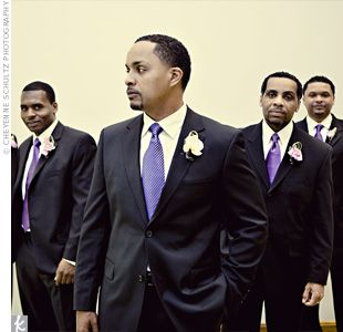 Robert and his groomsmen wore black tuxes and royal purple ties. Smoky spray rose boutonnieres were fastened to the groomsmen's lapels.