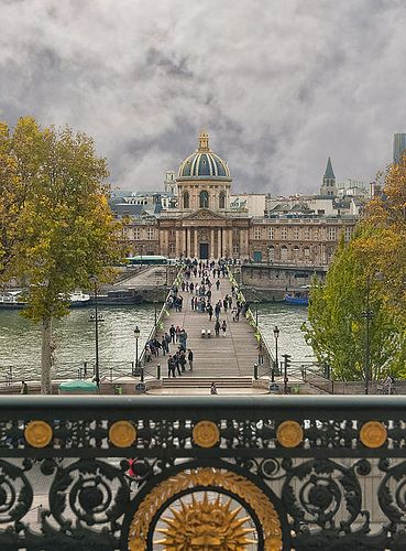 Le Pont des Arts ~ A pedestrian bridge crossing the Seine. It connects the Institut de France (pictured) and the Palais du Louvre.