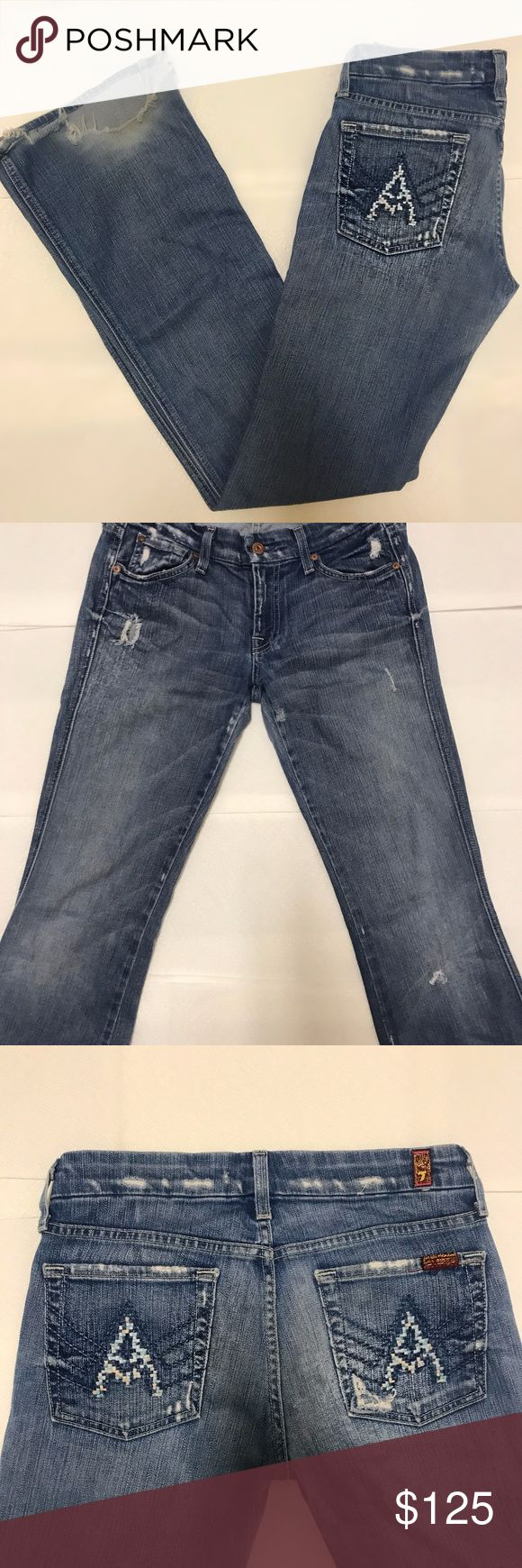 """7 For All Mankind Designer Women's Jeans They have zero stains with little visible wear. Wash bootcut flare with a slight grey tint and rare pink and blue embroidered """"A"""" design on back pockets. The rips shown are the BACK of the jeans not the front. I personally think they give a grunge hippy look to the jeans, however they can also be tailored in order to change it. 7 for all Mankind Jeans Boot Cut"""