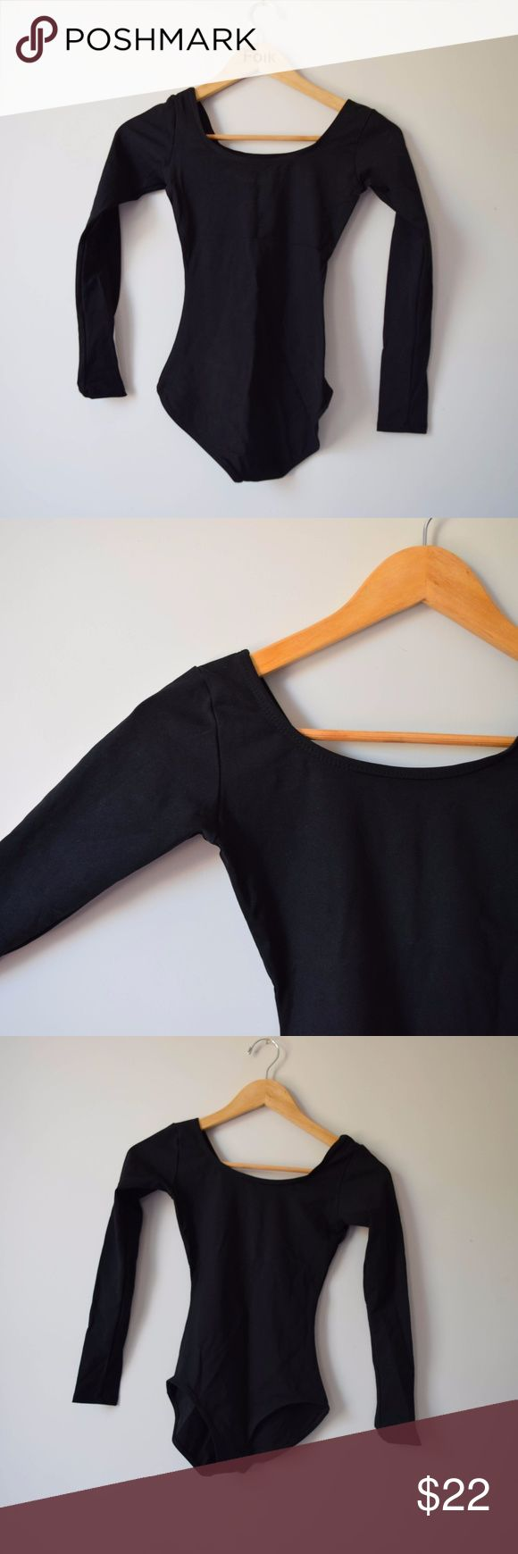 Capezio Long Sleeve Black Leotard NEW Capezio Leotard in black with long sleeves. No tags, but unworn and in perfect condition. Women's size SM. Perfect dance wear, activewear or for layering under shorts, skirts, jeans, sheer dresses! Capezio Other