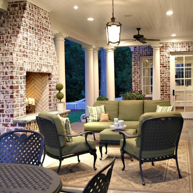 Lower level Back Porch with acid washed brick outdoor fireplace -- good spot for under a deck
