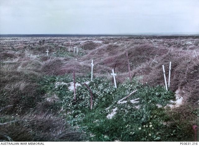 Scattered graves marked by simple white crosses on the old Somme battlefields, September 1917.