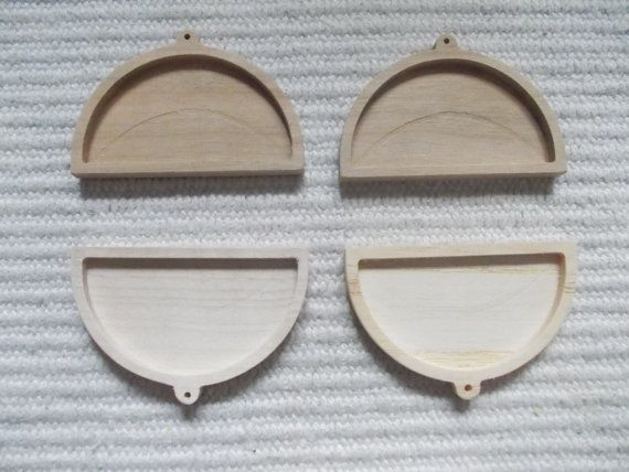 4 pc unfinished half round-shaped wooden pendant base with wooden hook,jewel tray,half round pendant setting, blank resin tray  4 pieces mix wooden half-round shaped pendant base for jewel making. In the centre of the pendant there is a cutout, which gives a more attractive look to the pendant.   https://www.etsy.com/listing/191720092/4-pc-unfinished-half-round-shaped-wooden?ref=related-0