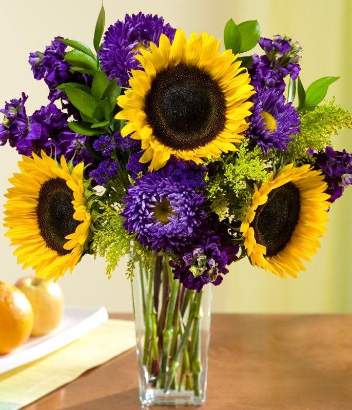 sunflower and purple wedding bouquet HMMMMMMMMMM...... maybe just what im looking for!