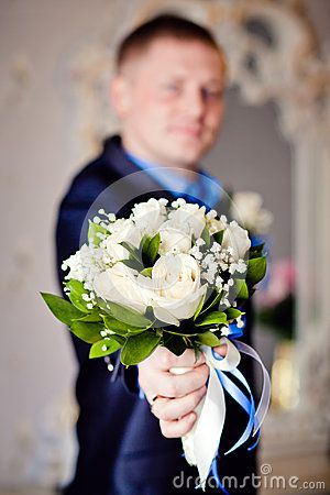Bouquet of white flowers with blur of background groom