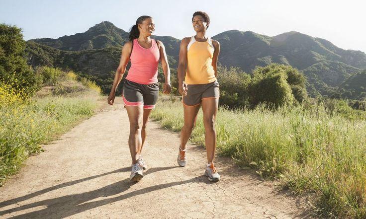Women walking briskly on trail together
