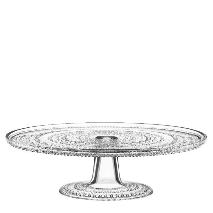 ittala Kastehelmi Cake Stand. The Kastehelmi range of glassware was designed in 1964 Oiva Toikka . Kastehelmi was one of Toikka's most popular designs and Iittala reintroduced a selection of the most popular pieces in 2010. A beautiful piece for those who love to bake and serve in style. A great gift to use again and again.